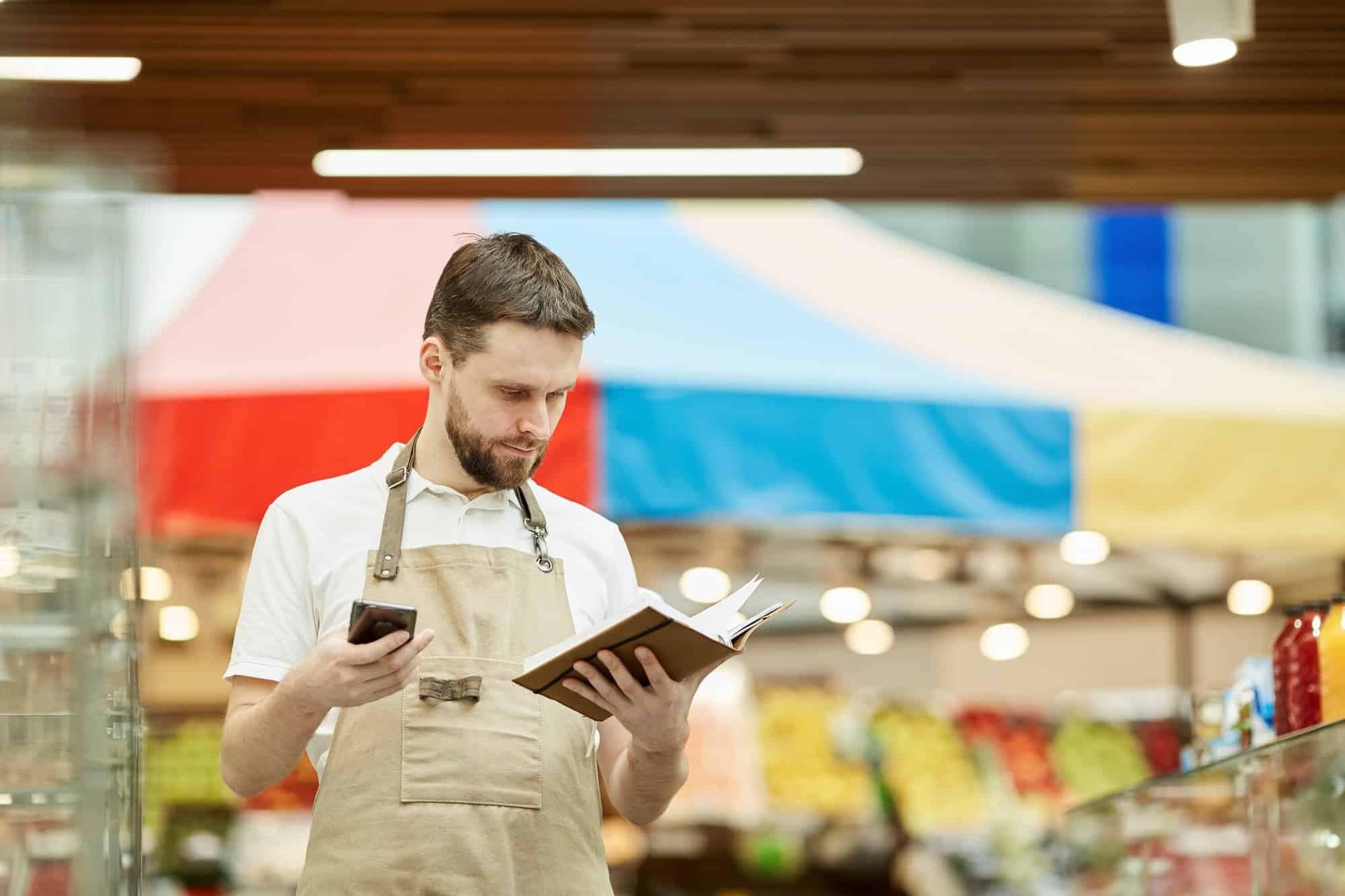 Supermarket Worker Calling Supplier