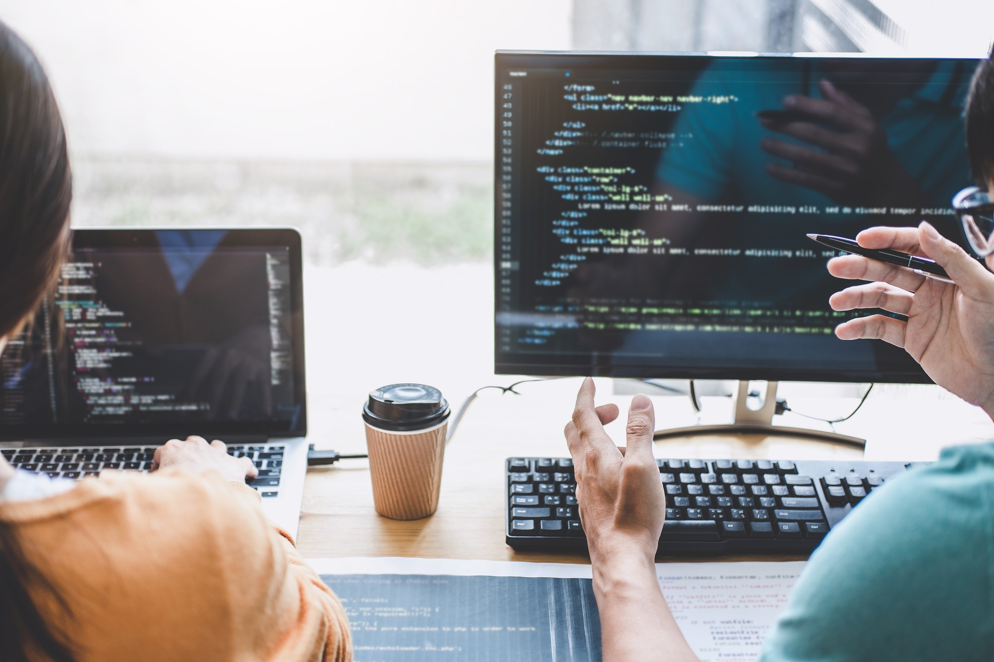 Information Security Experts reviewing software code